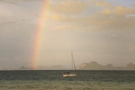 Sailingboat with rainbow